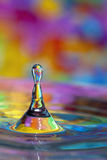 Colorful water drop and splash Stock Photography
