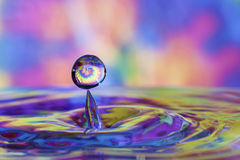 Colorful water drop and splash Royalty Free Stock Image