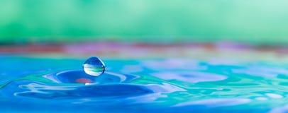 Colorful water droplet splash photograph. Color photo of a water droplet splash front view Stock Photo