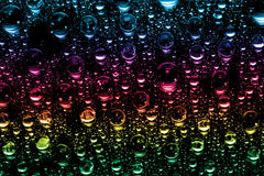 Colorful water drops Stock Images