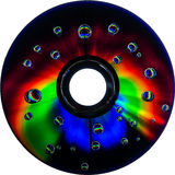 Colorful water drops on CD DVD disc Royalty Free Stock Photo