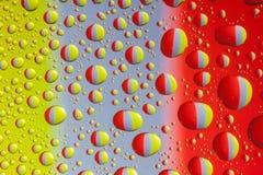 Colorful water drops. Many colorful water drops on even surface Royalty Free Stock Photos