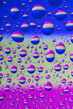 Colorful water drops. Many colorful water drops on even surface Royalty Free Stock Photography