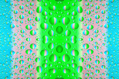 Colorful water drops. Many colorful water drops on even surface Royalty Free Stock Photo