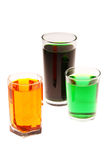 Colorful water in the glasses. Isolated on white background Stock Photography