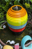 Colorful water jar, fountain in the garden, wallpaper background Stock Image