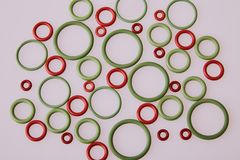 Colorful water level rubber gaskets scattered on the table. royalty free stock images
