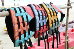 Colorful water life vest. S on hanger stock photography