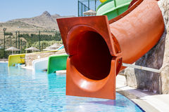 Colorful water park tubes and a swimming pool Stock Photography