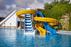 Colorful water park tubes and a swimming pool Royalty Free Stock Image