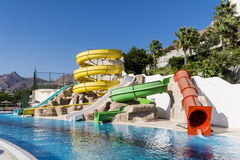 Colorful water park tubes and a swimming pool Royalty Free Stock Photo
