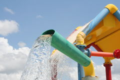 Colorful Water Pouring. Colorful water play area or waterpark with water pouring stock photo