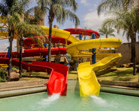 Colorful water slide in aqua park. Colorful red and yellow water slides in aqua park. Summer enjoy Stock Photo