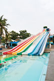 Colorful water slider. Lineal colorful striped water slider in the park Stock Images