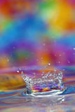 Colorful water splash Stock Images