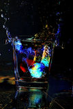 Colorful water splashing. From an ice holder stock images