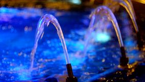 Colorful water in working fountain stock video