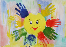 Colorful watercolor children handprints around the sun Stock Photo