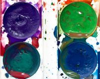Colorful watercolor paints stock photography