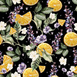 Colorful watercolor pattern with lavender flowers, anemones, and orange fruits. Stock Photos