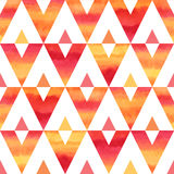 Colorful watercolor triangles seamless vector pattern. Watercolor triangles abstract seamless vector pattern. Fire or sunset tropical bright colors - red, orange Royalty Free Stock Photo