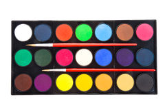 Colorful watercolors paints in palette with brushes isolated on Stock Image