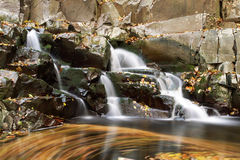 Colorful waterfall. With big rocks at autumn Royalty Free Stock Photography