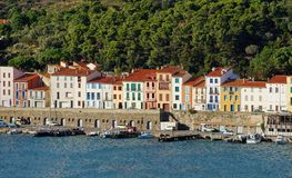 Colorful waterfront houses in a French harbor Stock Images