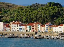 Colorful waterfront houses in a French harbor Stock Photos