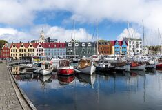 Colorful waterfront Nordic buildings and boats in Torshavn Harbour, Faroe Islands