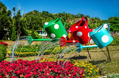 Colorful of watering can Stock Photos