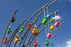 Colorful watering cans Stock Photo