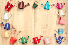 Colorful watering cans and buckets Stock Photos