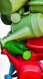 Colorful watering cans Royalty Free Stock Photos