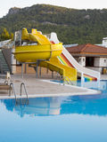 Colorful waterslides in water park pool and mountain Royalty Free Stock Photos