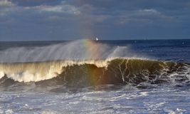 Colorful waves. As the waves crash it casts a beautiful rainbow Stock Images