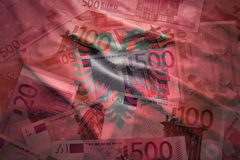 Colorful waving albanian flag on a euro background. Colorful waving albanian flag on a euro money background stock images