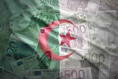 Colorful waving algerian flag on a euro  background Stock Photos