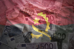 Colorful waving angolan flag on a euro  background. Colorful waving angolan flag on a euro money background Royalty Free Stock Image