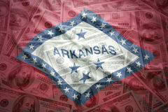 Colorful waving arkansas state flag on a american dollar background Royalty Free Stock Photography