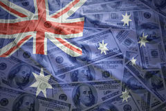 Colorful waving australian flag on a dollar money background Stock Image