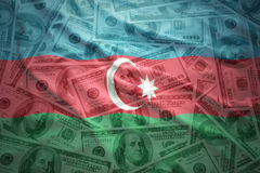 Colorful waving azerbaijani flag on a dollar money background. Colorful waving azerbaijani flag on a american dollar money background Stock Image