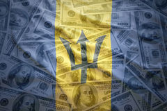 Colorful waving barbados flag on a  dollar money background Stock Image