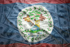 Colorful waving belize flag on a  dollar money background Stock Images