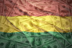 Colorful waving bolivian flag on a dollar money background Stock Photography