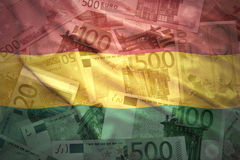 Colorful waving bolivian flag on a euro  background Stock Image