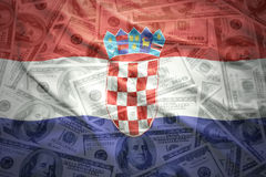 Colorful waving croatian flag on a dollar money background Stock Images