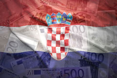 Colorful waving croatian flag on a euro background Royalty Free Stock Photos