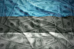 Colorful waving estonian flag on a dollar money background Royalty Free Stock Image