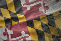 Colorful waving flag of maryland state on a american dollar money background. Royalty Free Stock Photo